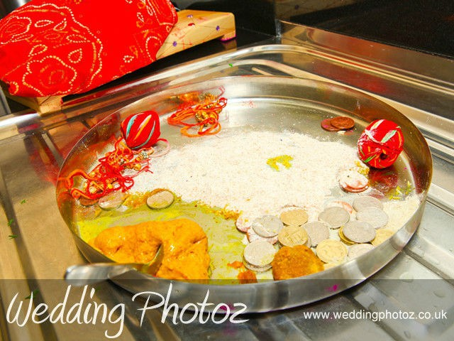 Sikh wedding photography Silver plate containing items for Surinder