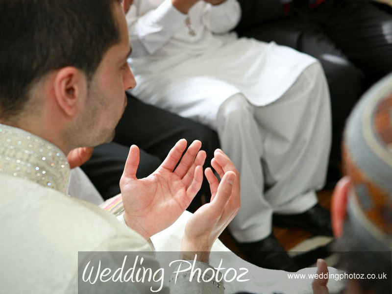 groom praying after the nikah marriage ceremony