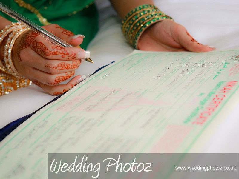 bride signing the nikah marriage certificate